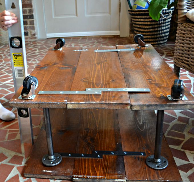 Screw flanges into top boards - DIY two-tier coffee table - Dogs Don't Eat Pizza