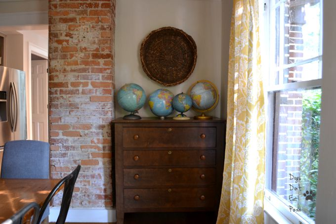 globe collection on buffet in dining room - Dogs Don't Eat Pizza