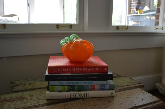 Adding pumpkins and warm colors decorating for fall - thediybungalow.com
