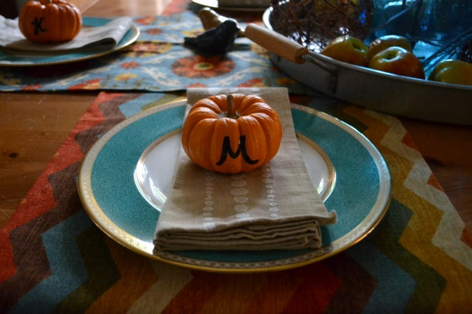 Pumpkins make fun placecard holders when decorating a table for fall - thediybungalow.com