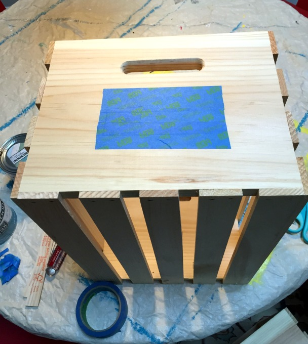 Taped off area of crate for chalkboard paint label - Personalized Hanukkah Gift Crate - thediybungalow.com