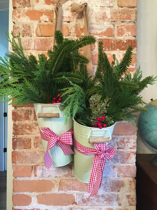 Holiday greenery in galvanized pails - thediybungalow.com