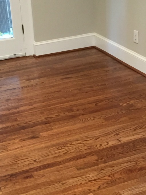 Hardwood floor refinished in family room - thediybungalow.com