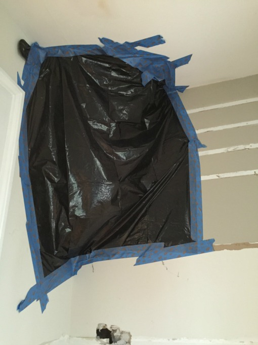 garbage bag and tape over mold - thediybungalow.com