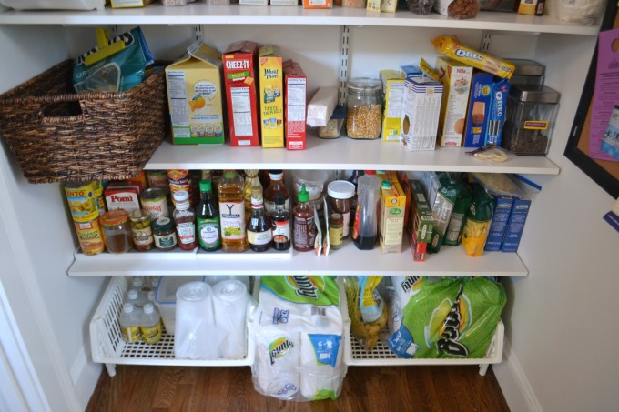 Bottom shelves of pantry for food storage - thediybungalow.com