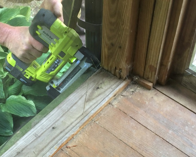 Use stapler to reattach screen when fixing screened porch - thediybungalow.com