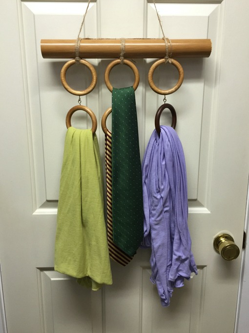 Repurposing curtain hardware - scarf and tie holder hung on back of door - thediybungalow.com