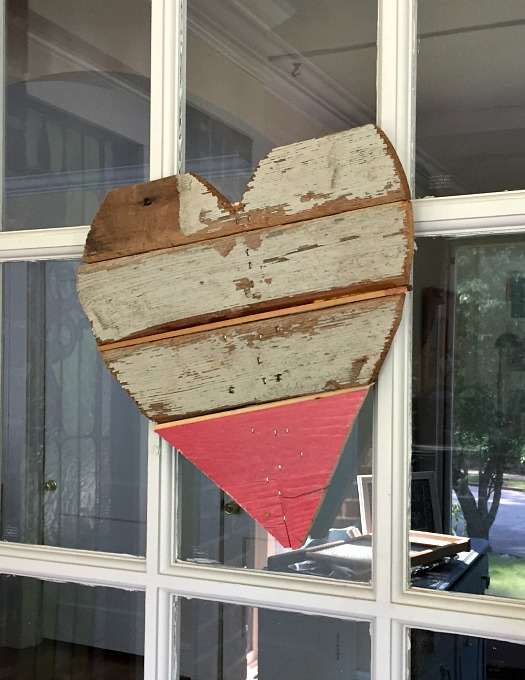 DIY scrap wood heart - hung on our door - thediybungalow.com