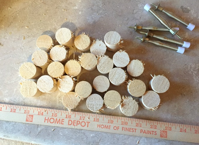 Sand the rough edges of the dowel to make a snowflake from hardware - thediybungalow.com