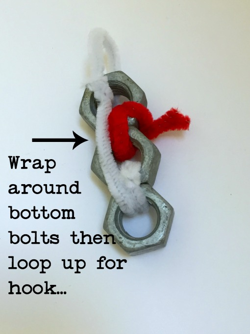 How to hang the snowman made from bolts to turn hardware into holiday decor for the tree - thediybungalow.com