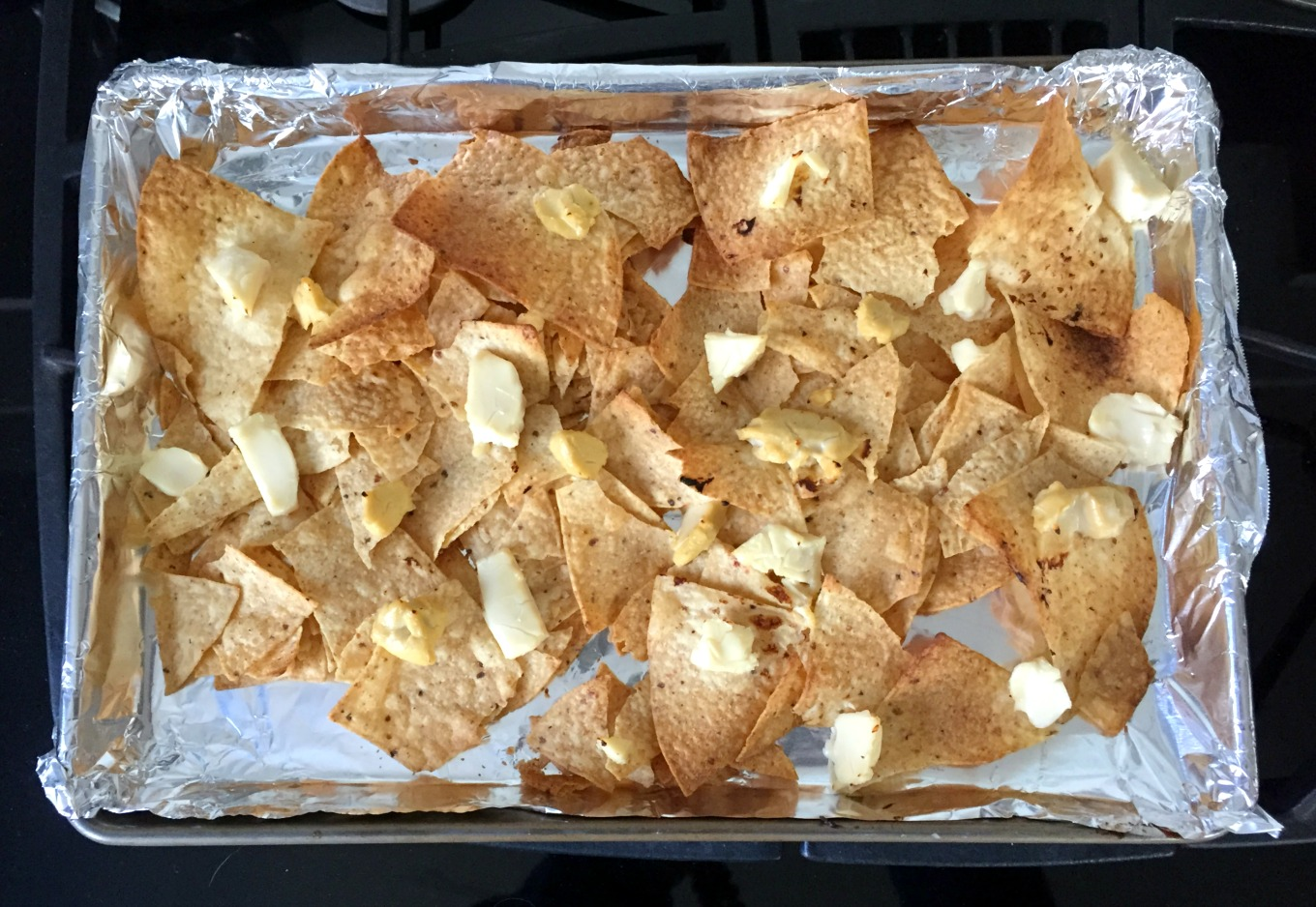 Melt in 400 degree oven to melt cheese and brown chips - thediybungalow.com