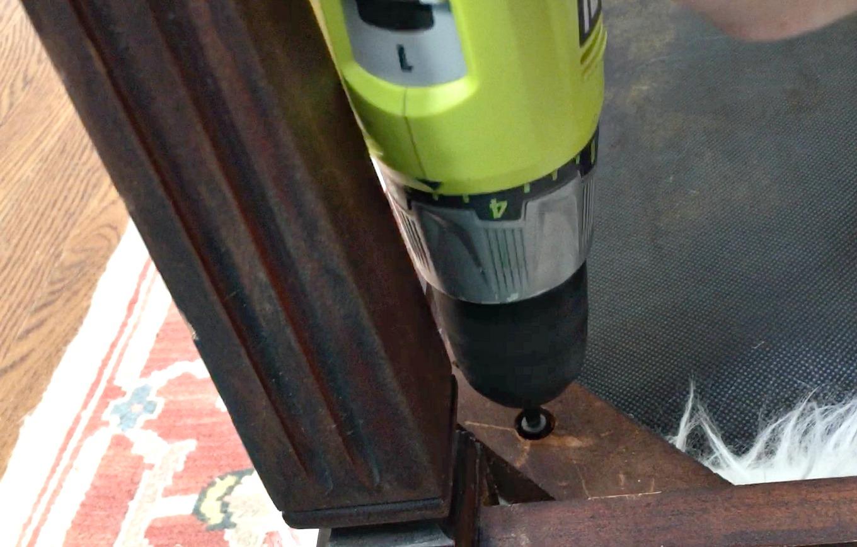 Screws in each corner of DIY faux fur foot stool - thediybungalow.com