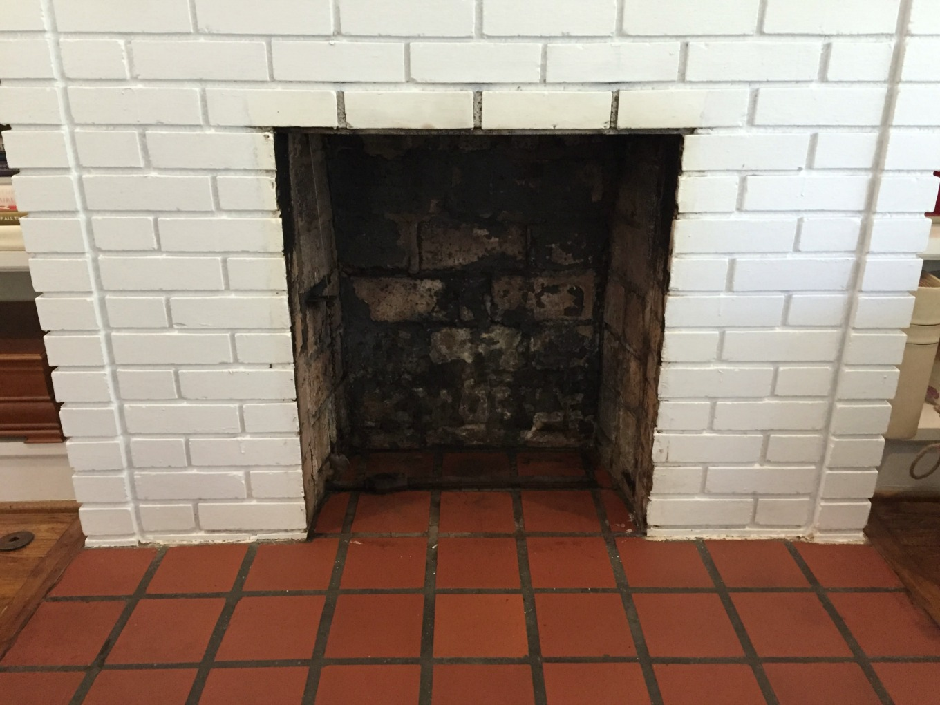 Cleaned fireplace firebox for fireplace makeover - thediybungalow.com