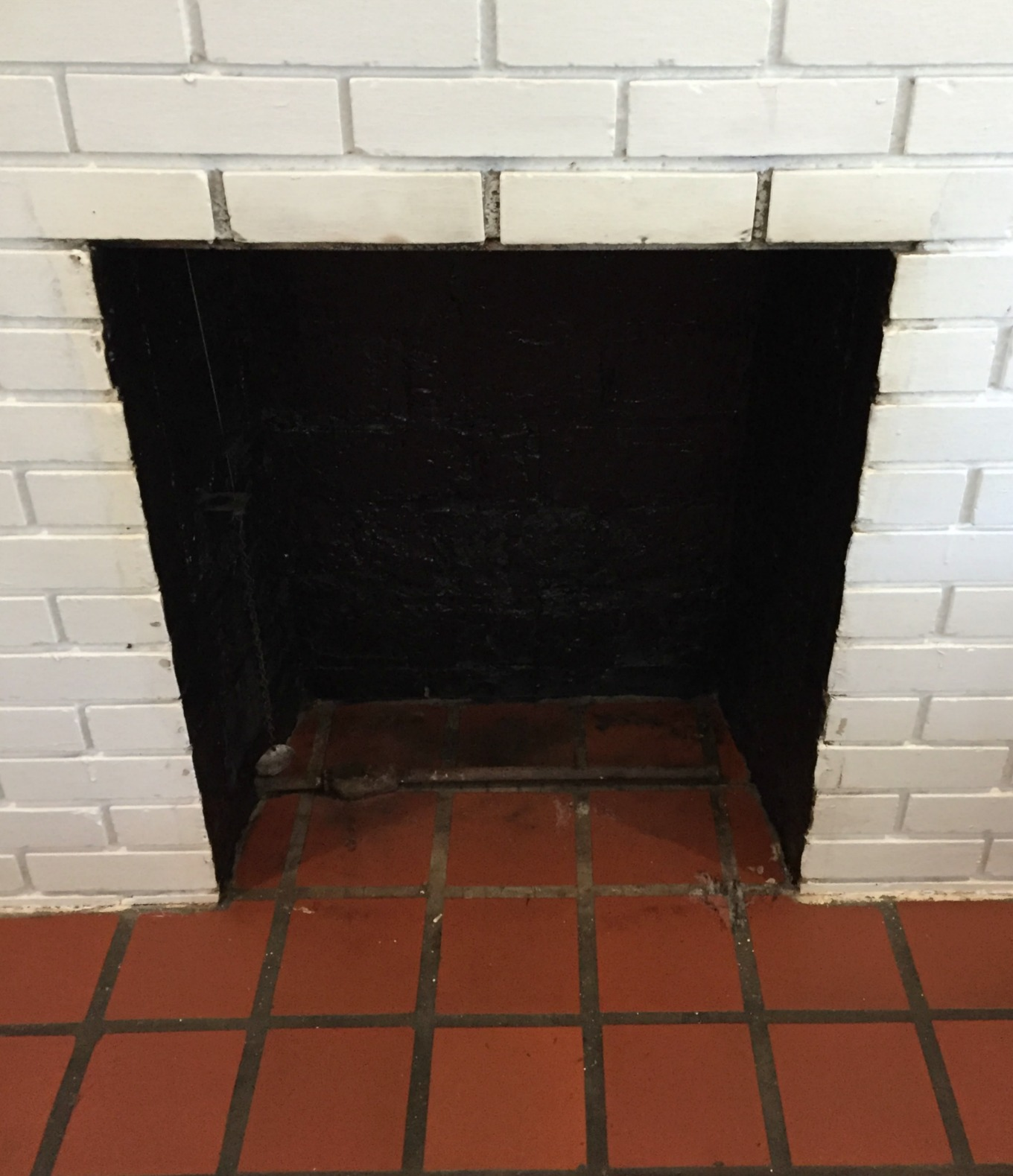 Inside of firebox painted black for fireplace makeover - thediybungalow.com