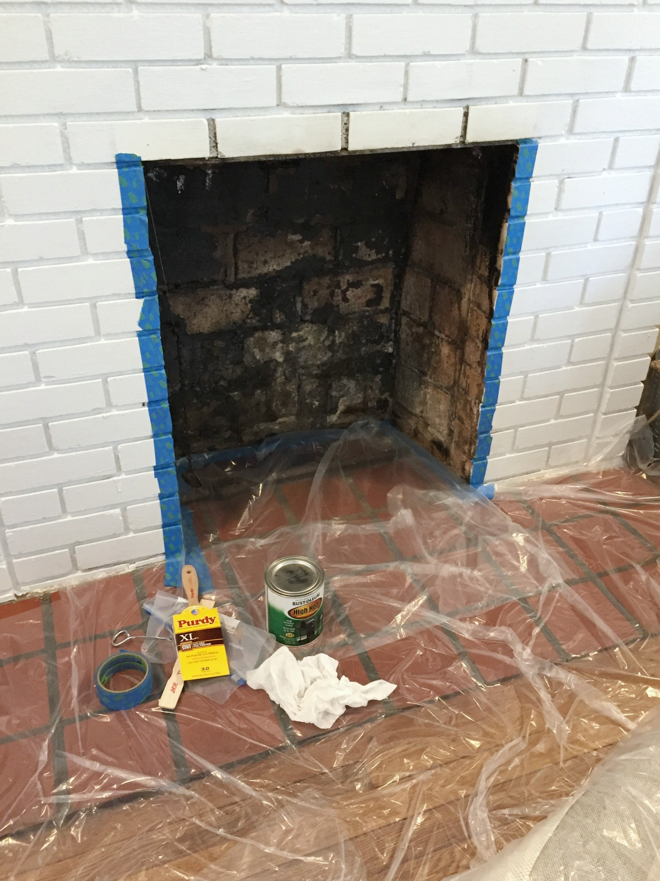Ready to paint the newly cleaned fireplace firebox - thediybungalow.com