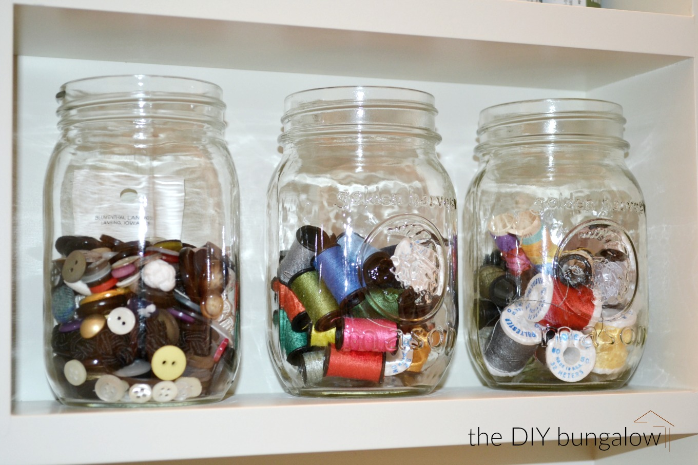 Corral thread and buttons in mason jars to be clutter-free in 2017 - thediybungalow.com