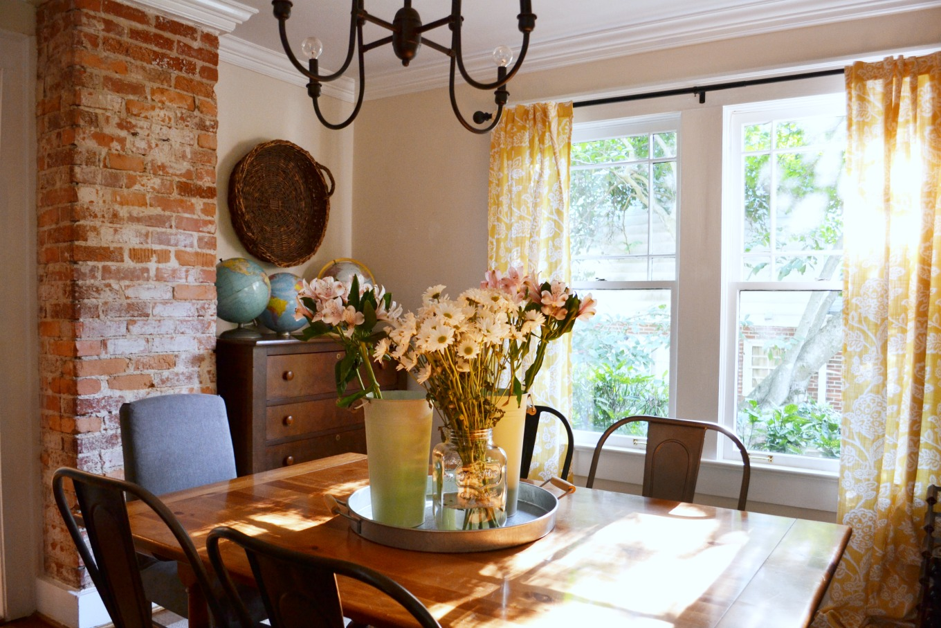 Dining room with fresh flowers to brighten decor for spring - thediybungalow.com