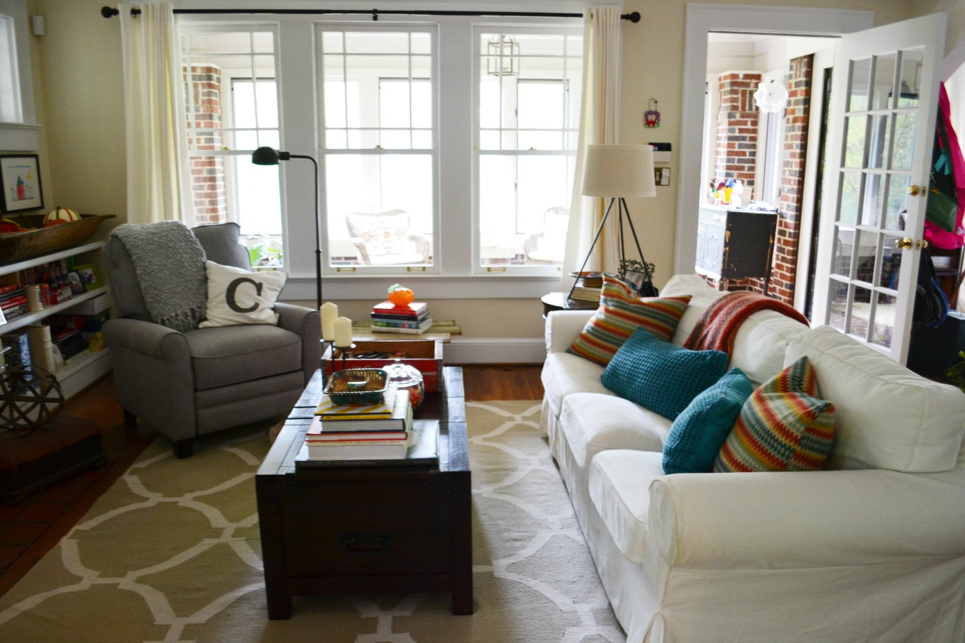 Living room before with chunky coffee table - thediybungalow.com