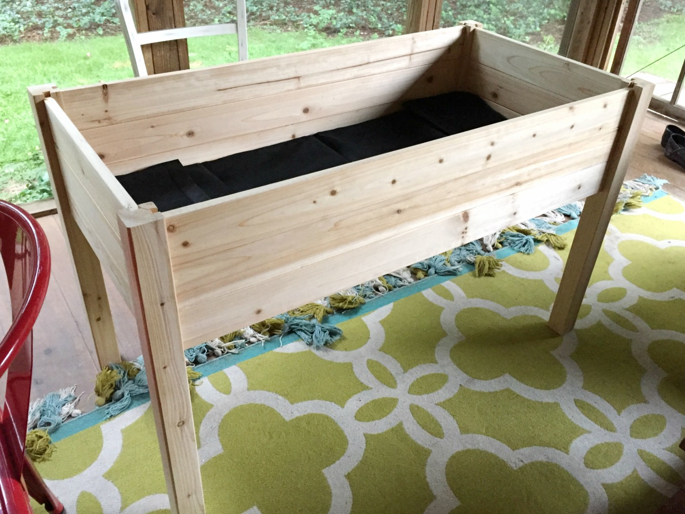 This raised garden bed took me about thirty minutes to build - thediybungalow.com