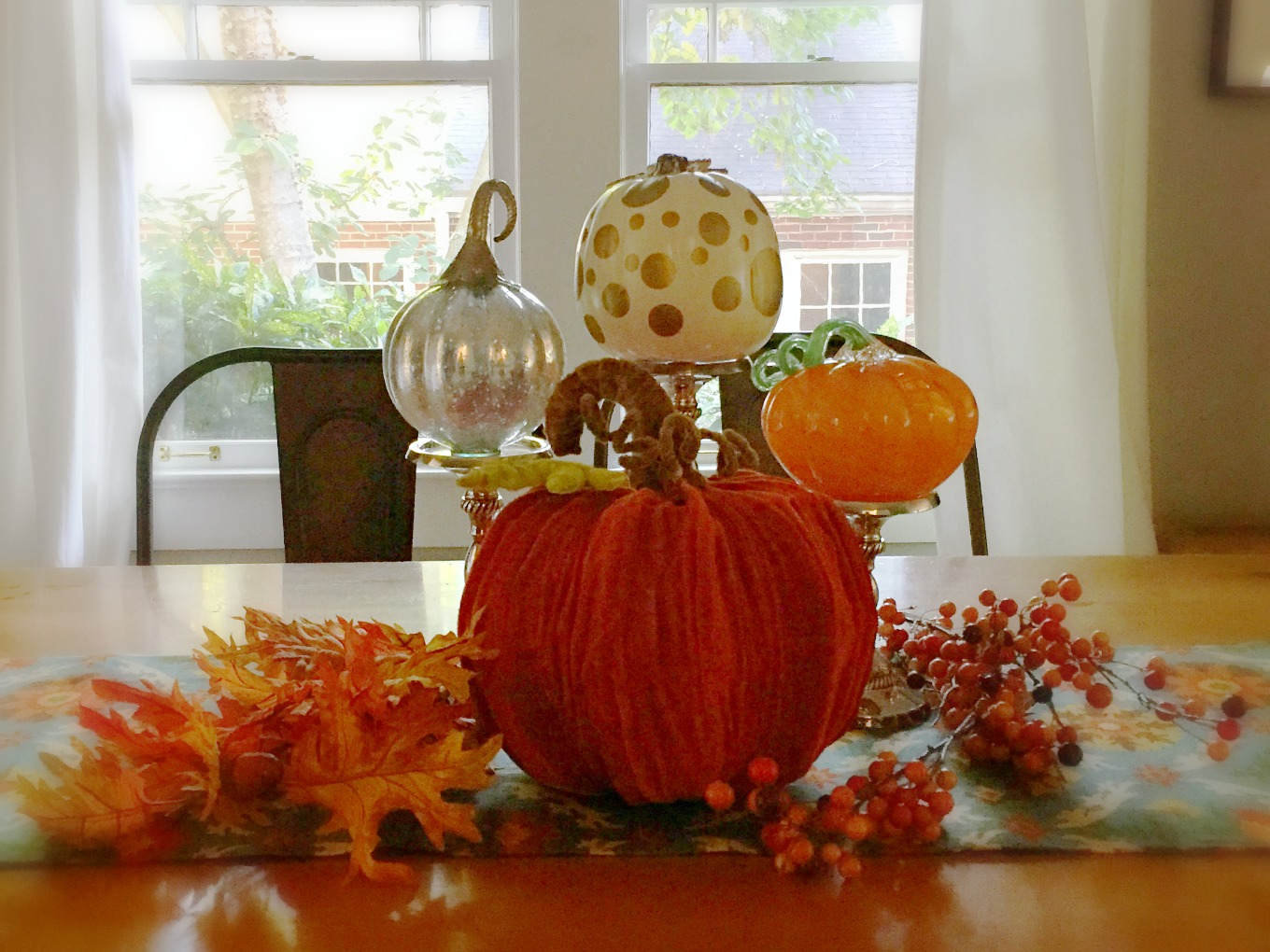 Easy fall centerpiece with leaves pumpkins and candlesticks - thediybungalow.com