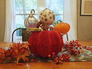 Thanksgiving gratitude - Pumpkins, leaves, and candlesticks make an easy fall centerpiece - thediybungalow.com