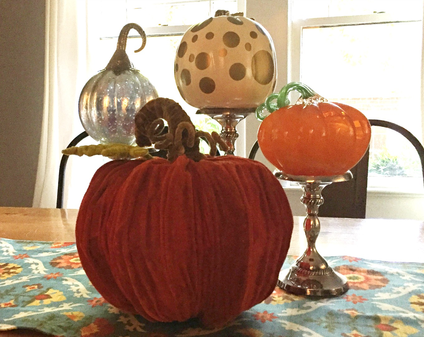 Start with a runner and an assortment of pumpkins for an easy fall centerpiece - thediybungalow.com
