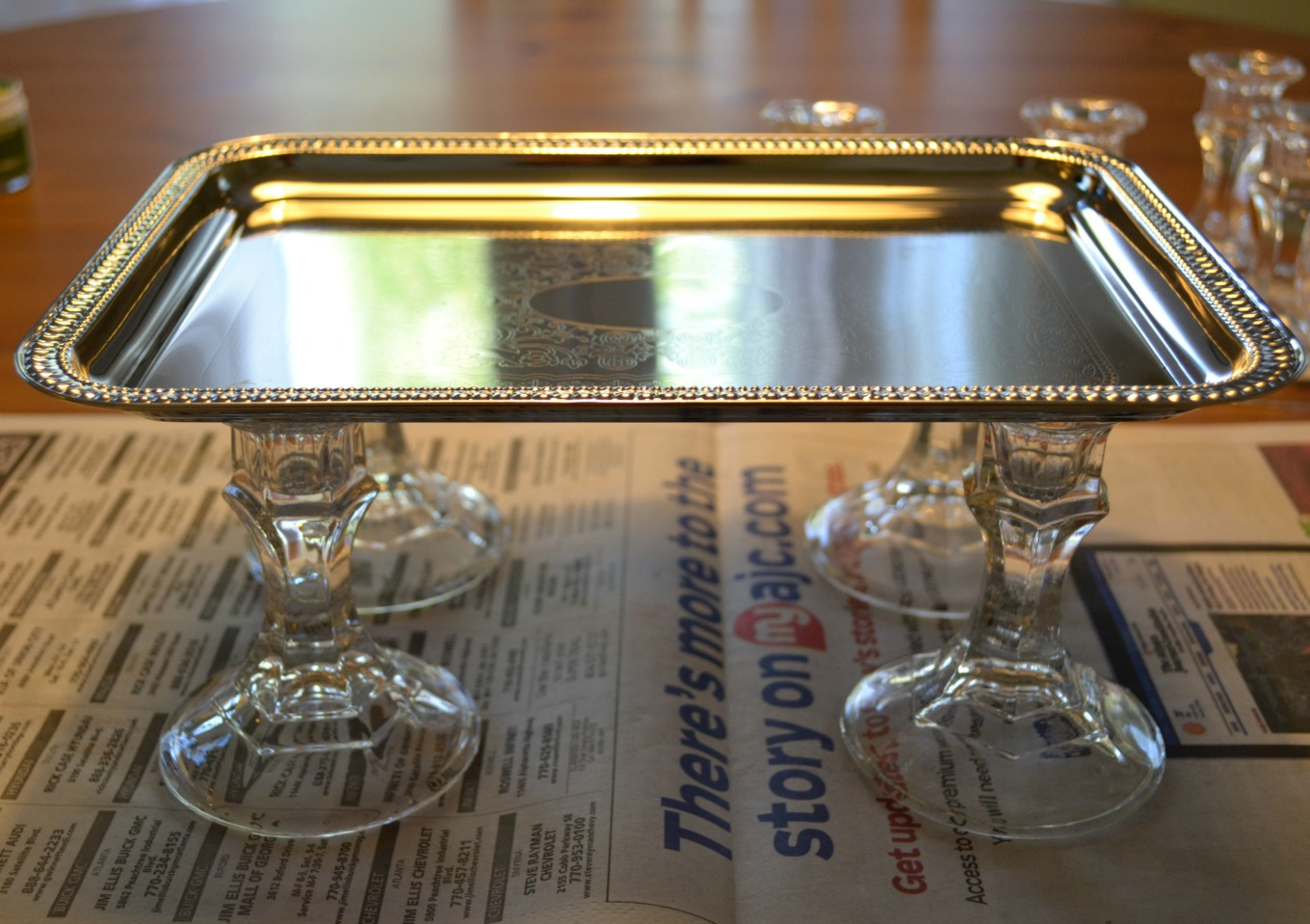 Dollar store tray on top of dollar store candlesticks creates a great bathroom tray - thediybungalow.com