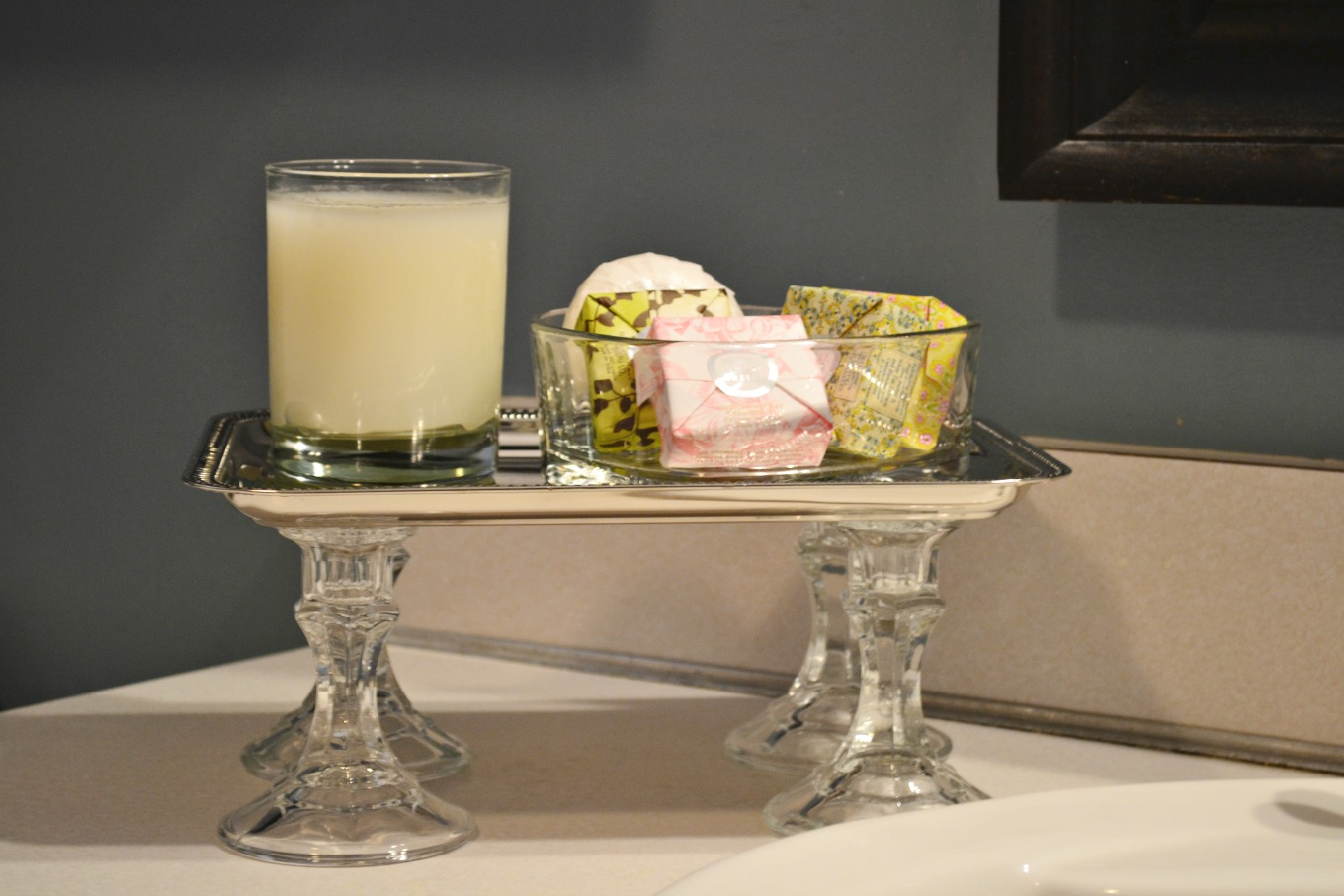 Make a dollar store bathroom tray using a dollar store tray and candlesticks - thediybungalow.com